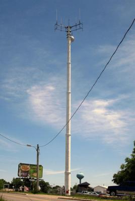 Rogers Wireless 850 & 1900 MHz antennas are located on this monopole in Strathroy, Ontario. Ericsson equipment cabinets just barely visible at the bottom.