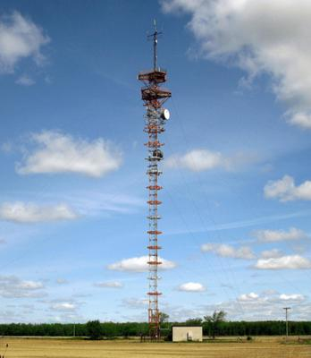 Older style tower being reused for a few microwave dishes and other unknown antennas up top.